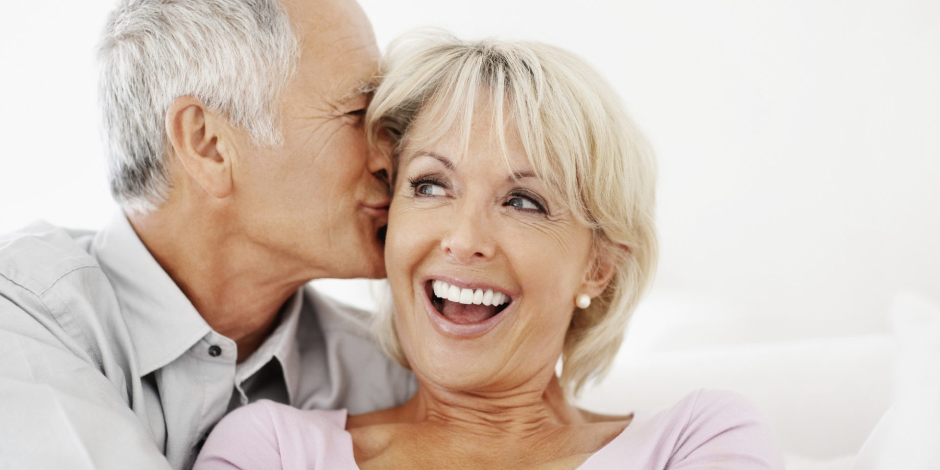 a happy older middle aged couple laughing and smiling with good hormones and hormone replacement therapy